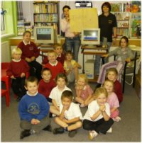 Nursery children with Edubuntu PCs
